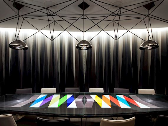 private dining room table covered in bright modern colors
