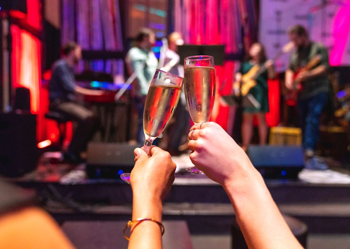 Champagne toast in front of stage